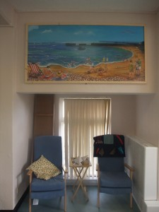Seaside mural showing Hastings habour arm and including all the 'feel good' images suggested by clients